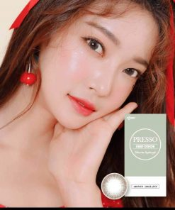 A Beautiful Asian girl wears Ann365 Ann Presso Brown colored contact lenses.