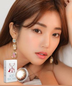 A Korean woman wears Ann365 Add Brown colored contact lens