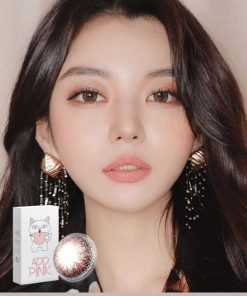 A beautiful asian girl wears Ann365 Add Pink colored contacts